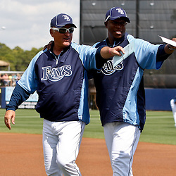 March 8, 2011; Port Charlotte, FL, USA; Tampa Bay Rays manager Joe Maddon (70) and Tampa Bay Buccaneers head coach Raheem Morris who served as a guest coach wave to the crowd before a spring training exhibition game against the Toronto Blue Jays at Charlotte Sports Park.   Mandatory Credit: Derick E. Hingle