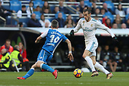 MADRID, SPAIN. January 21, 2018 - Gareth Bale with the ball against Luisinho. Doubles for Cristiano Ronaldo, Bale and Nacho, alongside Modric's sole strike, overturn Deportivo's early goal in a superb display of the Whites' firepower. Photos by Antonio Pozo | PHOTO MEDIA EXPRESS