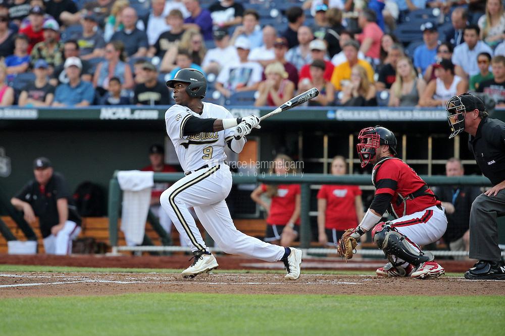 Xavier Turner #9 of the Vanderbilt Commodores bats during Game 2 of the 2014 Men's College World Series between the Vanderbilt Commodores and Louisville Cardinals at TD Ameritrade Park on June 14, 2014 in Omaha, Nebraska. (Brace Hemmelgarn)