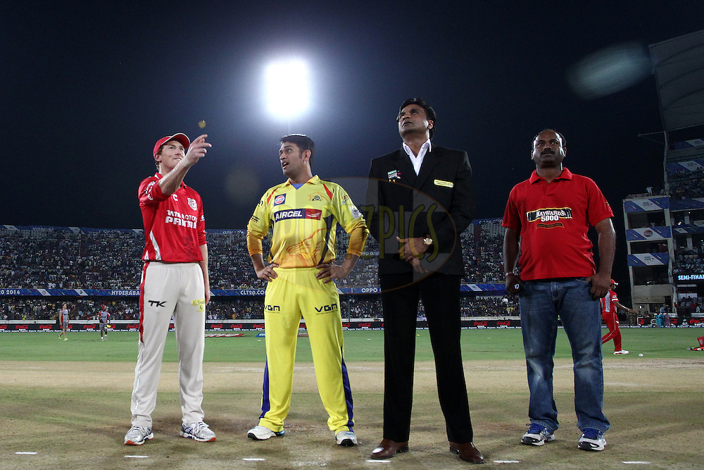Kings XI Punjab captain George Bailey tosses the coin as Chennai Super Kings captain MS Dhoni calls and Match Referee Javagal Srinath looks on during the second semi final match of the Oppo Champions League Twenty20 between the Kings XI Punjab and the Chennai Superkings held at the Rajiv Gandhi Cricket Stadium, Hyderabad, India on the 2nd October 2014<br /> <br /> Photo by:  Shaun Roy / Sportzpics/ CLT20<br /> <br /> <br /> Image use is subject to the terms and conditions as laid out by the BCCI/ CLT20.  The terms and conditions can be downloaded here:<br /> <br /> http://sportzpics.photoshelter.com/gallery/CLT20-Image-Terms-and-Conditions-2014/G0000IfNJn535VPU/C0000QhhKadWcjYs