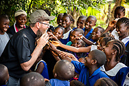 The Rev. Daniel Mulholland, team chaplain and pastor of Shepherd of the Valley Lutheran Church, Fort Bridger, Wyo., lets children feel his beard while he talks with children about Jesus Christ on the first day of the LCMS Mercy Medical Team on Monday, May 7, 2018, in the Yardu village outside Koidu, Sierra Leone, West Africa. LCMS Communications/Erik M. Lunsford