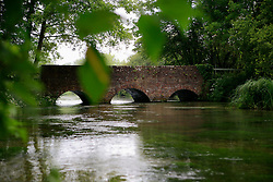 UNITED KINGDOM HAMPSHIRE 17JUN09 - A traditional arched bridge across the chalkstream river Itchen at Ovington in Hampshire, southern England...The river has a total length of 28 miles, and is noted as one of England's - if not one of the World's - premier chalk streams. It is designated as a Site of Special Scientific Interest and is noted for its high quality habitats, supporting a range of protected species...jre/Photo by Jiri Rezac / WWF UK..© Jiri Rezac 2009