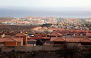 View over rooftops of villa housing in the Castillo development, Caleta de Fuste,  Fuerteventura, Canary Islands, Spain