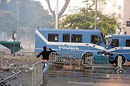 Roma  15 Ottobre 2011.Manifestazione contro la crisi e l'austerità.Scontri tra manifestanti e forze dell'ordine..Un mezzo della polizia  vieni assaltato dai manifestanti in pzza San Giovanni.
