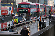 A cyclist waits behind a bus as traffic queues on London Bridge during the evening rush-hour, on 7th November 2018, in London, England.