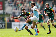 Mike Blair of Newcastle Falcons (centre) chips past Ben Youngs of Leicester Tigers (left) during the Aviva Premiership match at Welford Road, Leicester<br /> Picture by Andy Kearns/Focus Images Ltd 0781 864 4264<br /> 06/09/2014