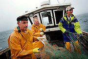 UK ENGLAND HASTINGS 6JUL06 - Fishermen David Peters, Graham Coglan and Paul White (L-R) at work aboard the St. Richard (RX60) of Hastings. Hastings Stade is home to Britain's biggest fleet of beach-launched fishing boats with a history dating back more than a thousand years. Photography by Jiri Rezac<br />
