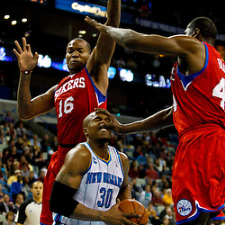 January 3, 2011; New Orleans, LA, USA; Philadelphia 76ers power forward Elton Brand (42) hits New Orleans Hornets power forward David West (30) in the face drawing a foul during the third quarter at the New Orleans Arena.   Mandatory Credit: Derick E. Hingle