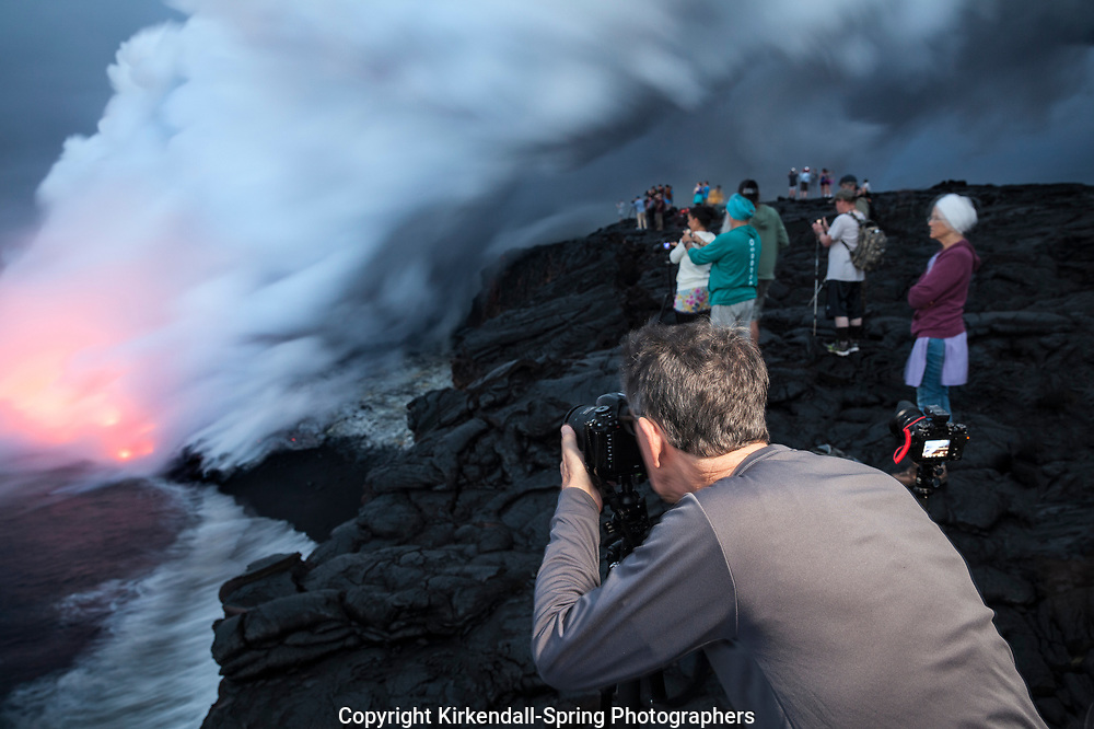 HI00286-00...HAWAI'I - People watching lava entering the ocean from the Pu'u O'o lava flow in Hawai'i Volcanoes National Park on the island of Hawai'i.