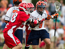 Virginia Cavaliers A Danny Glading (9) in action against cornell.  The #1 ranked Virginia Cavaliers defeated the #4 ranked Cornell Big Red 14-10 at Klockner Stadium on the Grounds of the University of Virginia in Charlottesville, VA on March 8, 2009.