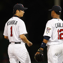 February 27, 2011; Fort Myers, FL, USA; Minnesota Twins second baseman Tsuyoshi Nishioka (1) and short stop Alexi Casilla (12) talk during a spring training exhibition game against the Boston Red Sox at Hammond Stadium.  Mandatory Credit: Derick E. Hingle