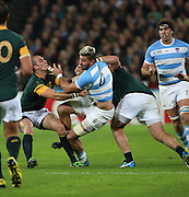 Argentina's Javier Ortega Desio getting tackled by two players during the Rugby World Cup Bronze Final match between South Africa and Argentina at the Queen Elizabeth II Olympic Park, London, United Kingdom on 30 October 2015. Photo by Matthew Redman.