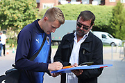 AFC Wimbledon striker Joe Pigott (39) signing autographs during the EFL Sky Bet League 1 match between AFC Wimbledon and Scunthorpe United at the Cherry Red Records Stadium, Kingston, England on 15 September 2018.