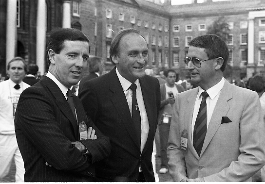 Nissan International Cycle Race..1986..01.10.1986..10.01.1986..1st October 1986..The Nissan Classic began today from Trinity College,Dublin. The offical race starter was The Taoiseach,Dr Garrett FitzGerald TD. He was accompanied by the Minister for Sport,Mr Sean Barrett TD..Sean Kelly was returning to defend his title but his opposition included Greg LeMond, the 1983 world champion and the winner of the Tour de France of the previous July. Roche was out due to his injured leg. Adri van der Poel was back with 1980 Tour de France winner and 1985 world champion Joop Zoetemelk. Teun van Vliet was back too. The winner of the green jersey of the Tour de France that July, Eric Vanderaerden was there as well as Australians Phil Anderson and Alan Peiper as well the Scottish cyclist Robert Millar...Photo shows Mr Gerard O'Toole,Managing Director,Nissan Ireland and minister for Sport,Mr Sean Barrett chatting with a Nissan race official prior to the start of the race.