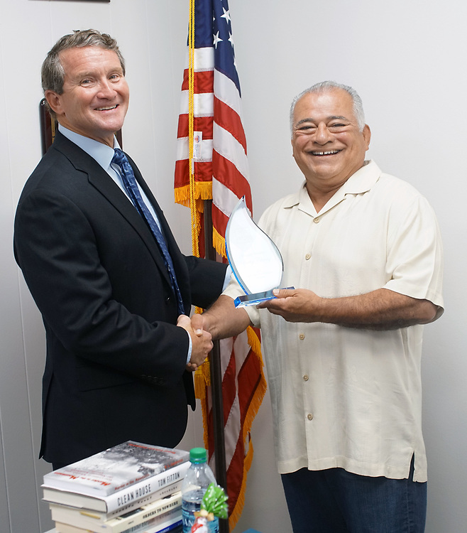 Councilman Rocky Chavez receives an award from Easter Seals from John Funk, Director of Operations, Bob Hope Veterans Support Program, at Chavez's office in Oceanside, CA on Friday July 14, 2017.(Photo by Sandy Huffaker/Easter Seals)