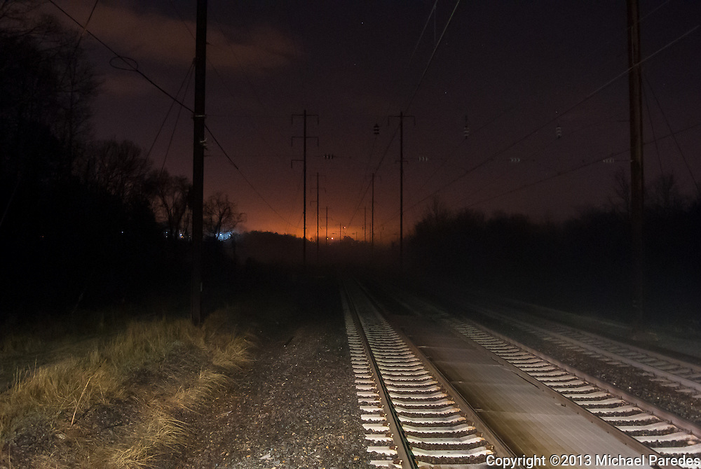 Pre-dawn train tracks leading south out of Baltimore Washington International Airport Amtrak station
