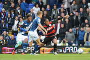 Birmingham City midfielder Demarai Gray battles with Queens Park Rangers midfielder Leroy Fer during the Sky Bet Championship match between Birmingham City and Queens Park Rangers at St Andrews, Birmingham, England on 17 October 2015. Photo by Alan Franklin.