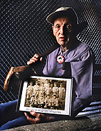 "Carl Stotz, the founder off the Little League, with a photo of the first champions, the 1939 Lycoming Dairy team, from Williamsport, Pennsylvania. Stotz, age 76, disdains ""the corporation"" that now runs Little League Baseball."