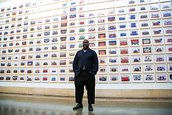 © Licensed to London News Pictures. 11/11/2019. London, UK. Turner Prize-winning artist and Oscar-winning filmmaker Steve McQueen poses for photographs at the preview of his Year 3 exhibition at Tate Britain. An installation of over 3,000 class photographs lining the walls of Tate Britain's Duveen Galleries, depicting more than 70,000 Year 3 pupils from London's primary schools.The exhibition opens on 12 November until 3 May 2020. Photo credit: Dinendra Haria/LNP