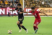 LAFC forward Carlos Vela (10) dribbles the ball while being defended by Toronto FC midfielder Jonathan Osorio (21)  during a MLS soccer game between the LAFC and the Toronto FC. LAFC and Toronto FC tied 1-1 on Saturday, Sept 21, 2019, in Los Angeles. (Ed Ruvalcaba/Image of Sport)