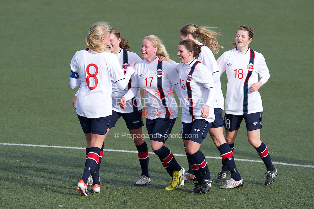 OSWESTRY, ENGLAND - Sunday, February 3, 2013: Wales' Therese Asland celebrates scoring the fourth goal against Norway during the Women's Under-19 International Friendly match at Park Hall. (Pic by David Rawcliffe/Propaganda)