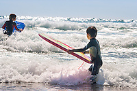 Two boys surfing at Westdale Bay<br /> Pembrokeshire<br /> South<br /> Surfing<br /> Activities and Sports