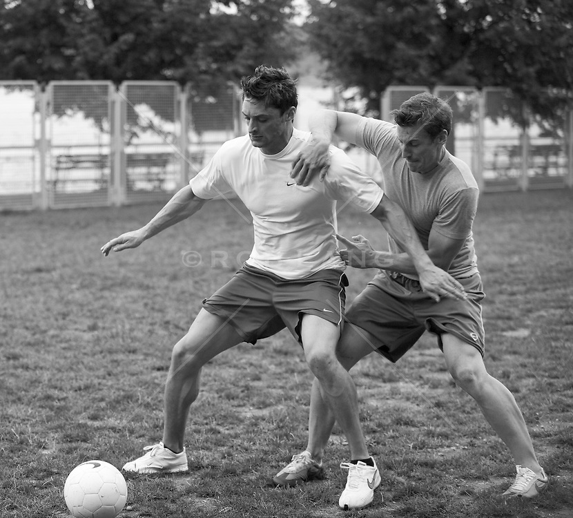 Two men playing soccer