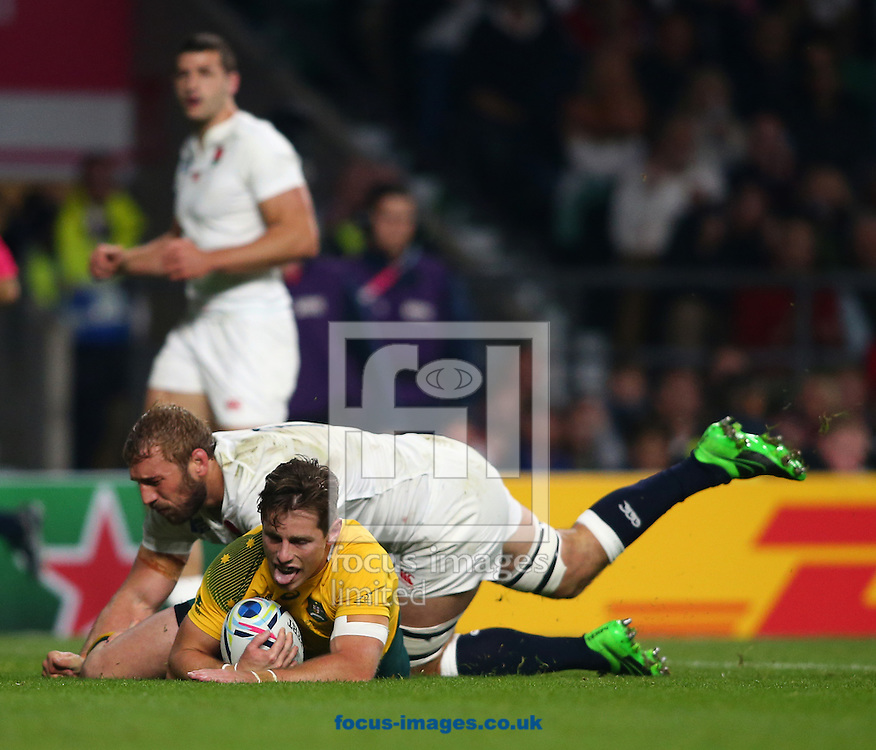 Bernard Foley of Australia scores their first try during the 2015 Rugby World Cup match at Twickenham Stadium, Twickenham<br /> Picture by Andy Kearns/Focus Images Ltd 0781 864 4264<br /> 03/10/2015