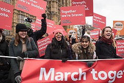 © Licensed to London News Pictures. 04/03/2018. LONDON, UK. Women with placards during the march. Hundreds of men and women take part in the annual March 4 Women campaigning for gender equality.  The walk through central London from Millbank to Trafalgar Square retraces the steps of Suffragette's ahead of International Women's Day on 8 March.  Photo credit: Stephen Chung/LNP