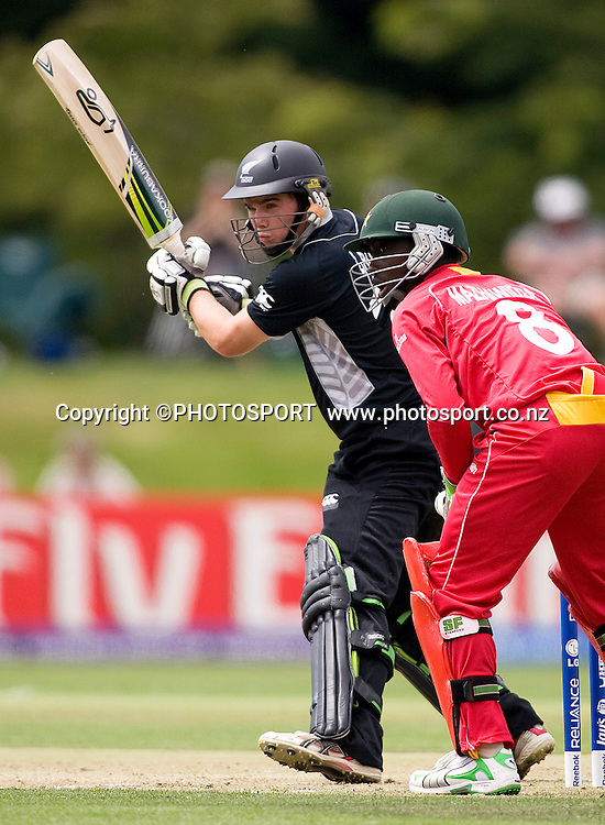 New Zealand's Tom Latham during his innings with Zimbabwe's wicket keeper Dean Mashawidza. New Zealand v Zimbabwe, U19 Cricket World Cup group stage match, Bert Sutcliffe Oval, Lincoln, Tuesday 19 January 2010. Photo : Joseph Johnson/PHOTOSPORT