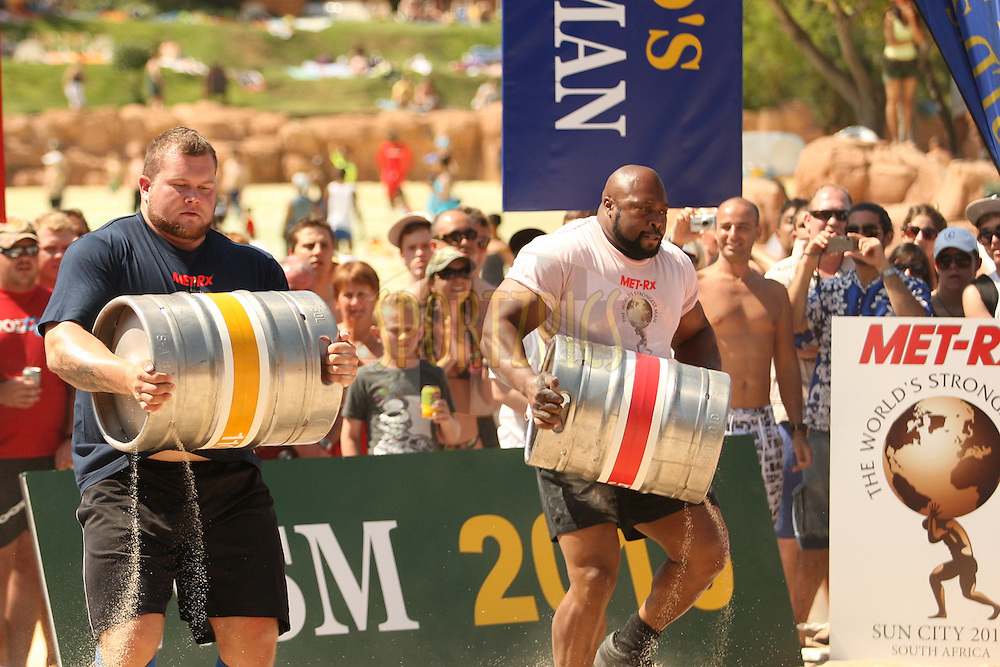 Stefan Solvi Peturssen (Iceland) on the left and Mark Felix (Uk) battl it out during the keg race, one of the qualifying rounds of the World's Strongest Man competition held in Sun City, South Africa.