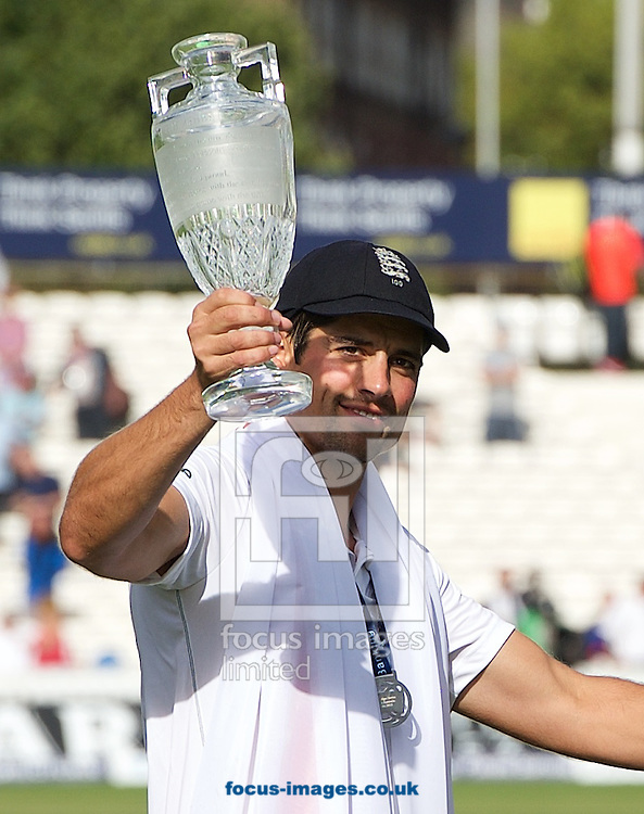 Captain Alastair Cook of England with the trophy after winning the Ashes test series during the 5th Investec Ashes Test match at the Kia Oval, London<br /> Picture by Alan Stanford/Focus Images Ltd +44 7915 056117<br /> 23/08/2015