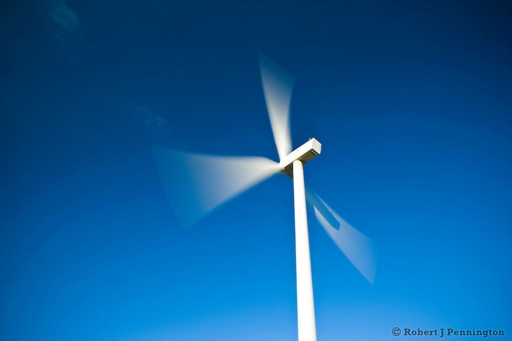 Wind turbine in southeast Washington against a clear blue sky.