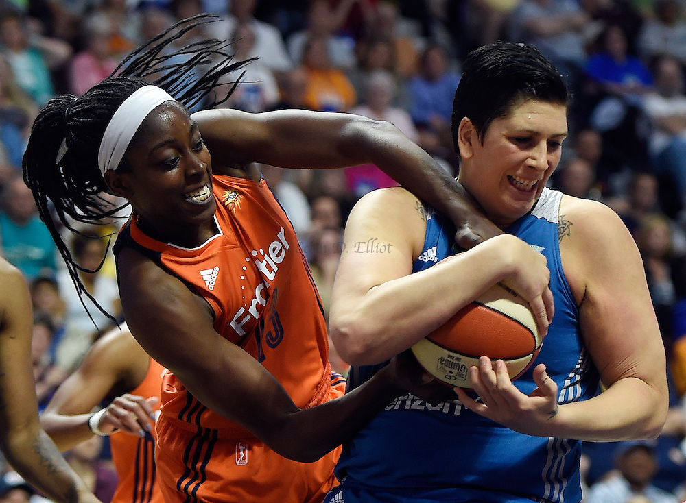 7/7/16 :: SPORTS :: GRIFFEN :: Connecticut's Chiney Ogwumike ties-up Minnesota's Janel McCarville for a jump ball in WNBA action Thursday, July 7, 2016 at Mohegan Sun Arena. (Sean D. Elliot/The Day)