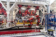 CASSINO, ITALY - NOVEMBER 24: A robot stands in the Body Shop where they assemble the Alfa Romeo Giulia in the Cassino Assembly Plant FCA Group. This is the most highly-automated area of the plant with nearly 1300 robots installed on November 24, 2016 in Cassino, Italy.