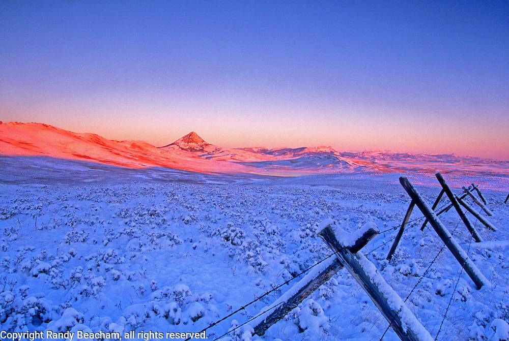 Haystack Butte & the Rocky Mountain Front at dawn after a fall snowstorm. Near Augusta, Montana