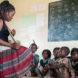 Teacher and kids in a classroom. Kafue National Park primary school, Zambia, Africa.
