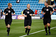 match Referee John Busby and his linesmen warm up before kick off during the EFL Sky Bet League 1 match between Gillingham and Bradford City at the MEMS Priestfield Stadium, Gillingham, England on 12 August 2017. Photo by Andy Walter.