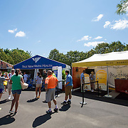 August 16, 2014, New Haven, CT:<br /> Fans crowd the AETNA, Yale New Haven Health, and First Niagara booths on day four of the 2014 Connecticut Open at the Yale University Tennis Center in New Haven, Connecticut Monday, August 18, 2014.<br /> (Photo by Billie Weiss/Connecticut Open)