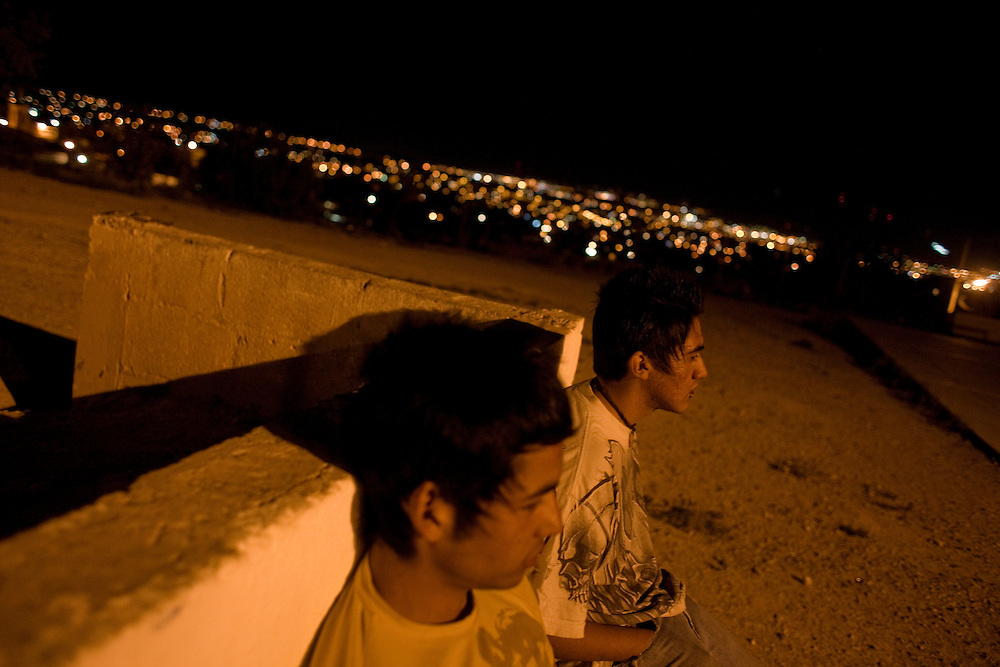 "Friends hang out in the Diaz Ordaz colonia, some of which are members of the ""Noveno"" gang in Ciudad Juarez, Chihuahua on May 12, 2010."