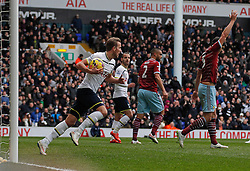 Tottenham Hotspur's Harry Kane with the ball after scoring a goal as West Ham's James Tomkins appeals for offside - Photo mandatory by-line: Mitchell Gunn/JMP - Mobile: 07966 386802 - 22/02/2015 - SPORT - football - London - White Hart Lane - Tottenham Hotspur v West Ham United - Barclays Premier League