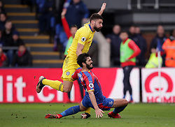Chelsea's Olivier Giroud shoots under a challenge from Crystal Palace's James Tomkins, leading to Giroud going off injured, during the Premier League match at Selhurst Park, London.