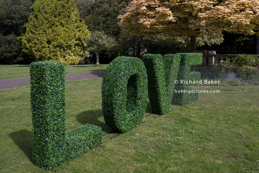 The trimmed topiary forming the letters spelling Love in a public park, on 22nd April 2017, in Clevedon, North Somerset, England.