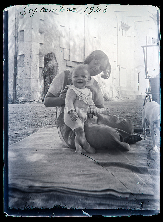 happy mother with smiling little baby toddler France 1923