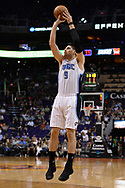 Mar 17, 2017; Phoenix, AZ, USA; Orlando Magic center Nikola Vucevic (9) shoots the ball against the Phoenix Suns in the first half of the NBA game at Talking Stick Resort Arena. Mandatory Credit: Jennifer Stewart-USA TODAY Sports