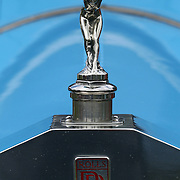 The emblem on a 1921 Rolls Rotce Silver Ghost at the Greenwich Concours d'Elegance Festival of Speed and Style featuring great classic vintage cars. Roger Sherman Baldwin Park, Greenwich, Connecticut, USA.  2nd June 2012. Photo Tim Clayton