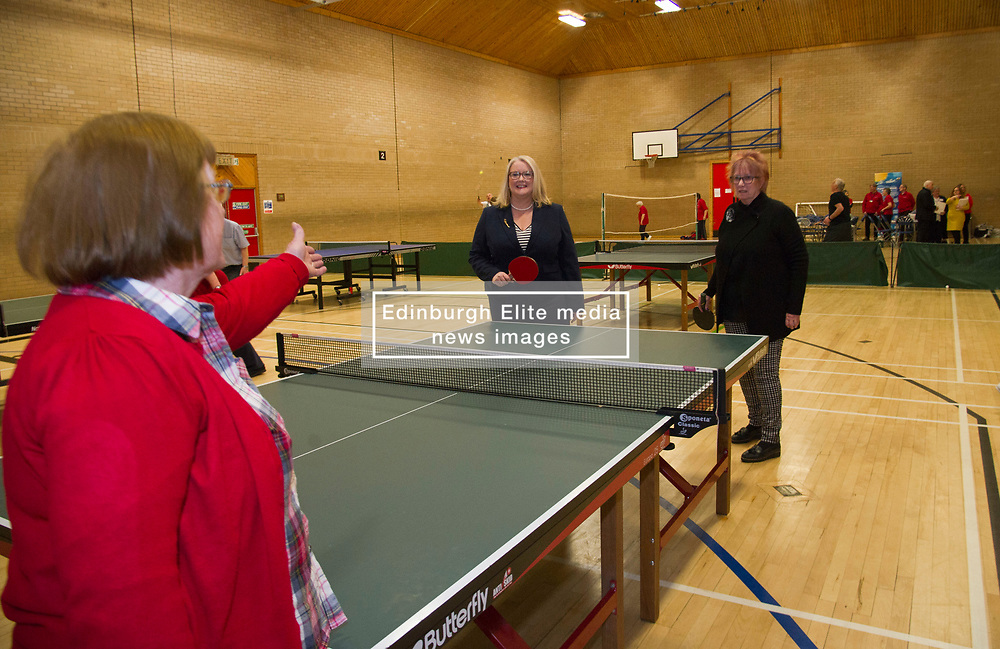 """Pictured: Equalities Minister Christina McKelvie and Christine Grahame took up the challenge of a game of table tennis and took things rather seriously<br /> .<br /> Equalities Minister Christina McKelvie visited Ladywood Leisure Centre in Penicuik today where she was joined by local MSP Christine Grahame to meet volunteers and participants at the centre as she launched the new framework<br /> <br /> Older people's rights are at the centre of a new framework to ensure people can remain active, keep working if they want to, feel safe, and access the services they need.  The Older People's Framework aims to challenge unwelcome attitudes to and discrimination towards older people. It highlights the positive contributions older people make to our society and the economy, and has been directly influenced by older people who have provided their thoughts, stories and experiences, bringing to life the issues they've faced over the years.<br />  <br /> Speaking at a visit to The Ageing Well Midlothian programme, Older People and Equalities Minister Christina McKelvie said: """"Ageing is inevitable but growing older should not mean having to face barriers or discrimination, and one of the issues the framework addresses is the negative perceptions surrounding ageing. Older people in our society have much to offer and contribute and we are committed to supporting them.  This is why we are funding the celebration of older people at the Festival of Ageing, increasing digital inclusion, promoting fair workplace practices and ensuring we have a housing system which works for an ageing population. This framework is the next part of the journey and I am looking forward to an exciting trip, where we all work together to create the best country to age in.  You only need to look at the Ageing Well project to see the many positive examples of older people enjoying life and bringing joy to their local community. This is what we need to encourage.""""<br /> <br /> <br /> Ger Harley 