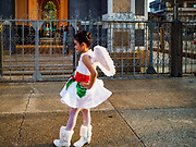"23 DECEMBER 2018 - CHANTABURI, THAILAND: A girl performing in the pageant waits to go on stage at the Cathedral of the Immaculate Conception's Christmas Fair in Chantaburi. Cathedral of the Immaculate Conception is holding its annual Christmas festival, this year called ""Sweet Christmas @ Chantaburi 2018"". The Cathedral is the largest Catholic church in Thailand and was founded more than 300 years ago by Vietnamese Catholics who settled in Thailand, then Siam.   PHOTO BY JACK KURTZ"