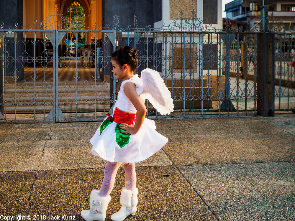 """23 DECEMBER 2018 - CHANTABURI, THAILAND: A girl performing in the pageant waits to go on stage at the Cathedral of the Immaculate Conception's Christmas Fair in Chantaburi. Cathedral of the Immaculate Conception is holding its annual Christmas festival, this year called """"Sweet Christmas @ Chantaburi 2018"""". The Cathedral is the largest Catholic church in Thailand and was founded more than 300 years ago by Vietnamese Catholics who settled in Thailand, then Siam.   PHOTO BY JACK KURTZ"""