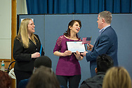 Wyandanch, New York, USA. March 26, 2017. At right, RICH SCHAFFER, Chairman of Suffolk County Democratic Committee, accepts Certificate of Appreciation and American Flag presented by, (center) BETH McMANUS, and (left) SUE MOLLER, two administrators of Together We Will Long Island. Schaffer spoke at Politics 101 event, the first of a series of activist training workshops for members of TWW-LI, the L.I. affiliate of TWW.